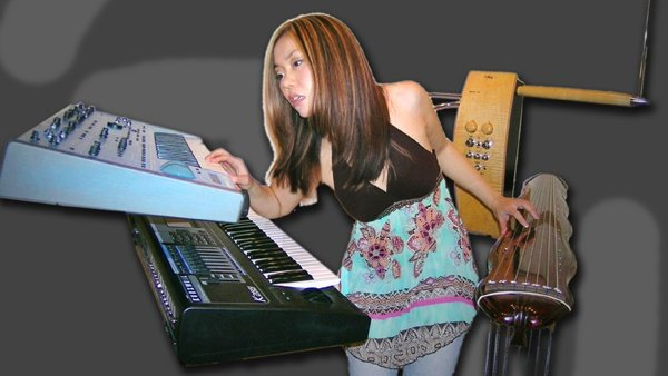 Shueh-li Ong with her synthesizers, Theremin and Guqin