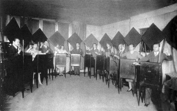 "Photo of the ""Ten Victor Theremins"" theremin orchestra."