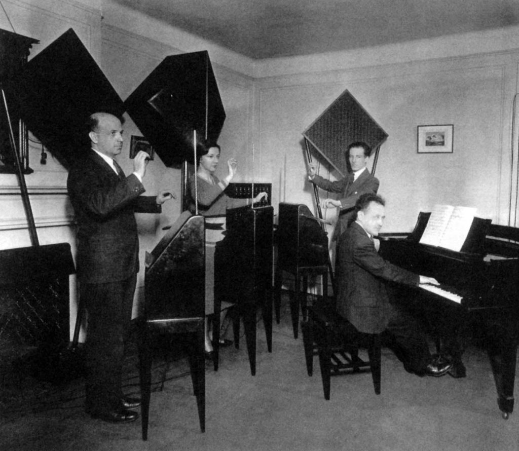 Photo of thereminist Zenaide Hanenfeldt playing with an ether Music Trio in 1930.